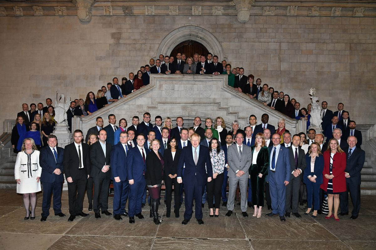 New MPs pose with the Prime Minister on their first day in Westminster. Their first week was spent trying to get themselves organised.
