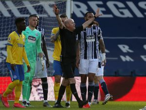 Chaos reigns as referee Lee Mason tries to decide whether to give the goal scored by Brighton and Hove Albion from a free kick (AMA)