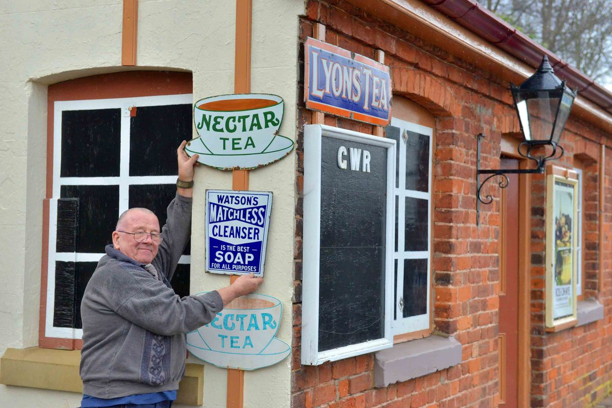 Bill Newman from Telford hangs some signs up at Eardington halt station on the Severn Valley Railway