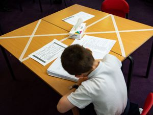 Social distancing measures as a child studies on a marked table at Kempsey Primary School in Worcester. Nursery and primary pupils could return to classes from June 1 following the announcement of plans for a phased reopening of schools. PA Photo. Picture date: Monday May 18, 2020. See PA story HEALTH Coronavirus Schools. Photo credit should read: Jacob King/PA Wire.