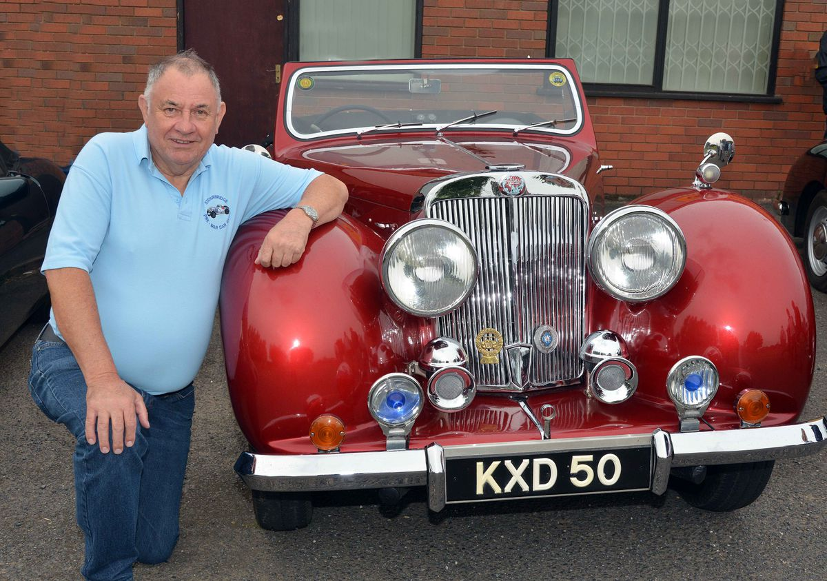 Alan Bateman in front of his 1949 Triumph Roadster sports car