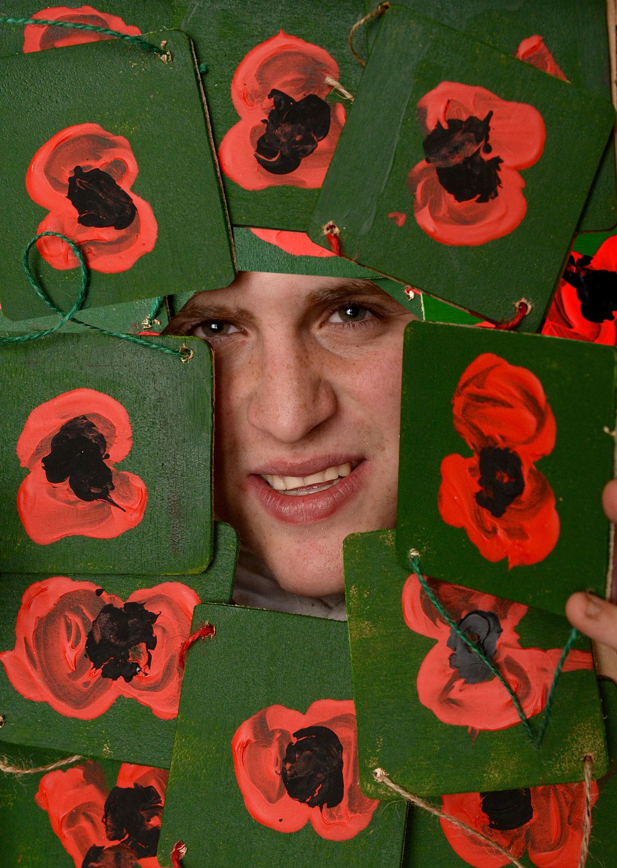 Charlie Teague with his poppy plaques..