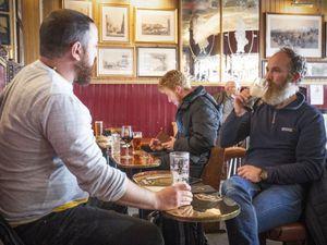 Men drink in pub