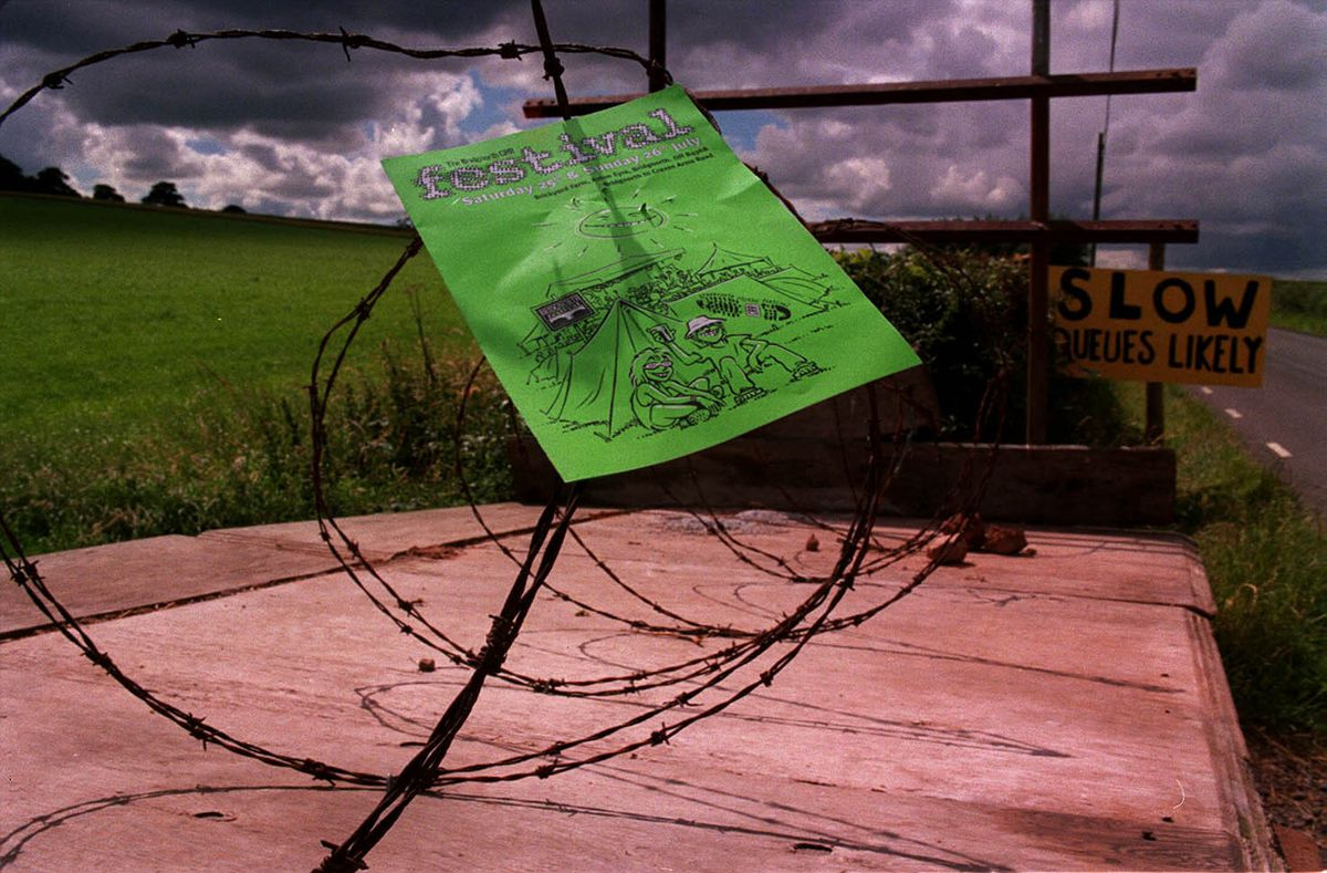 This unhappy farmer blocked his field with trailers and barbed wire. A leaflet for the festival blows in the wind.
