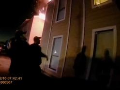 In Video: Officers save boy who jumps from burning building