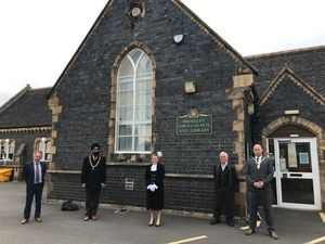 Town mayor councillor Tarlochen Singh-Mohr, left centre, alongside Shropshire High Sheriff Dean Harris, deputy mayor councillor Mark Garbett, right, and members of the town council and library