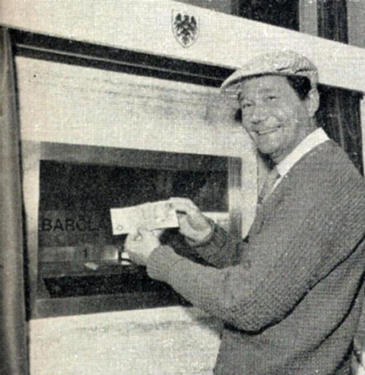 Comedy actor Reg Varney becomes the first customer to use a cashpoint 50 years ago