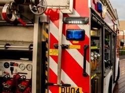 Firefighters tackle blaze involving rubbish and trees near Market Drayton