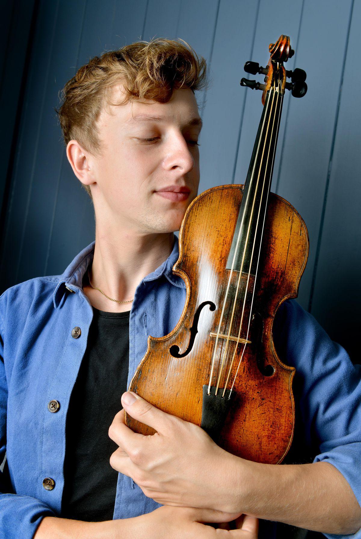 Conor Gricmanis with the 1572 Andrea Amati violin