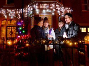 The Watton family singing Christmas carols: Sarah, Amy,  Rebecca and Mike