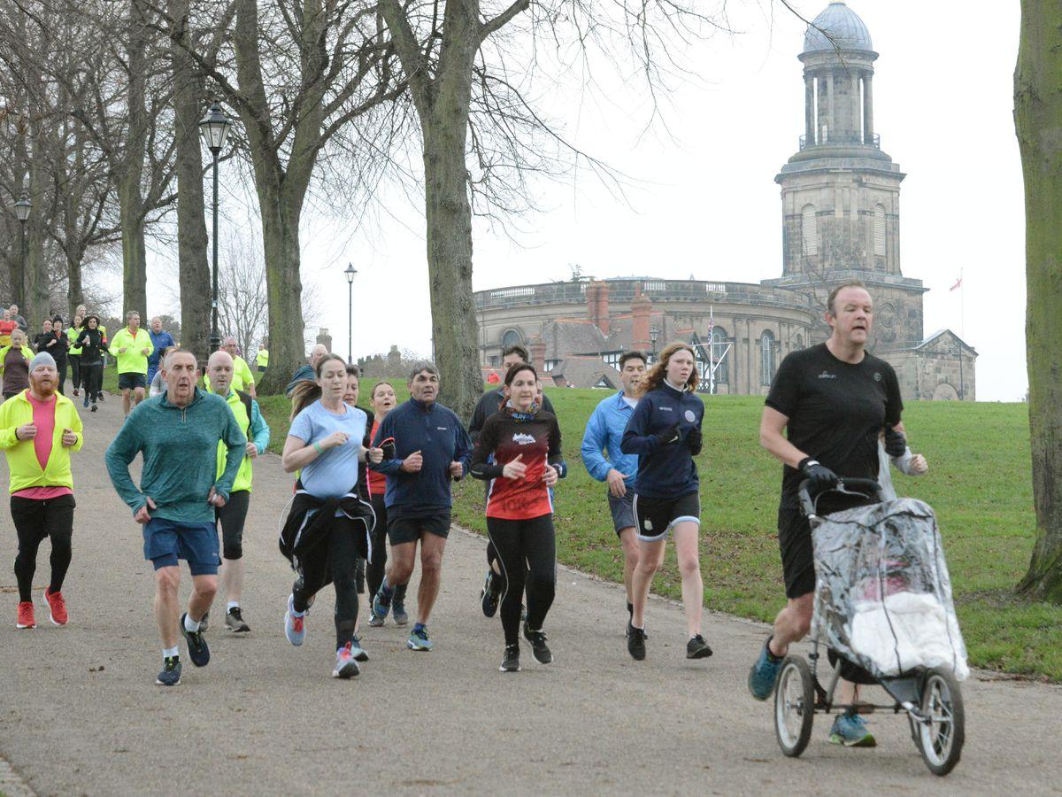 Runners in a park run at The Quarry, Shrewsbury