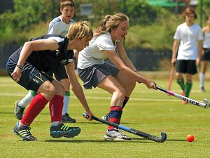 Oswestry's Grace Garry and Telford's Kyle Gladwin take part in hockey in 2013