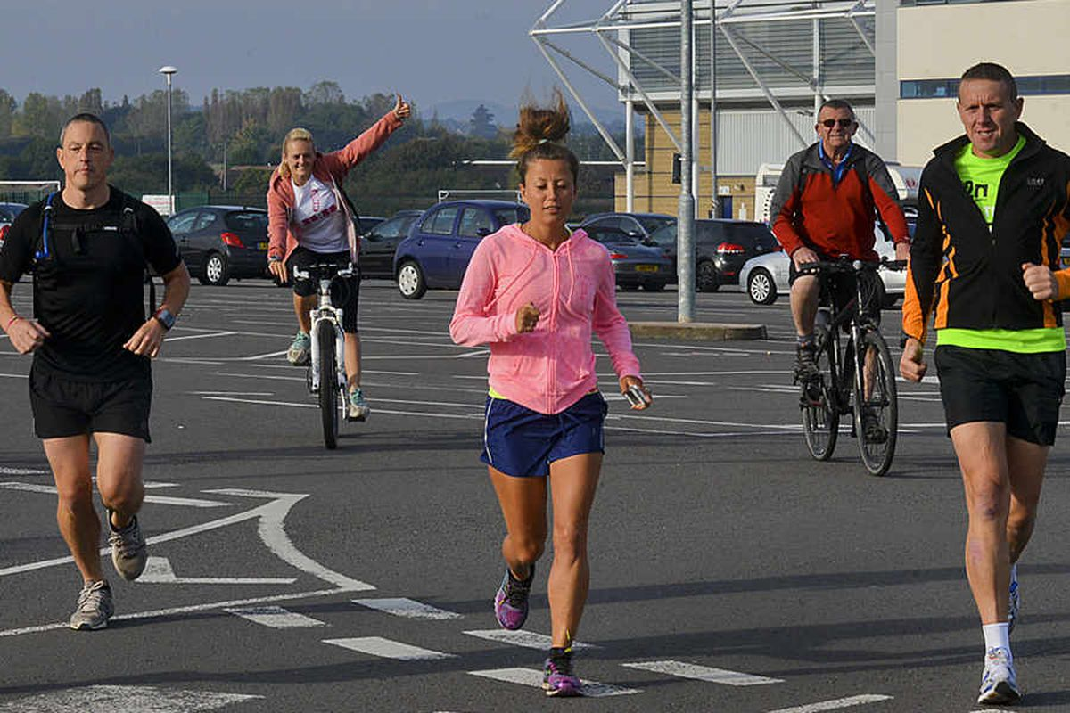 Amy Hughes on the road in Shrewsbury for her 48th marathon in 48 days