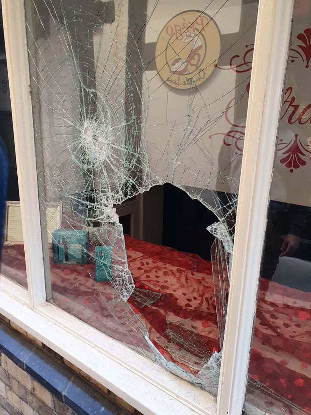 The smashed window at Strands in Grope Lane, Shrewsbury