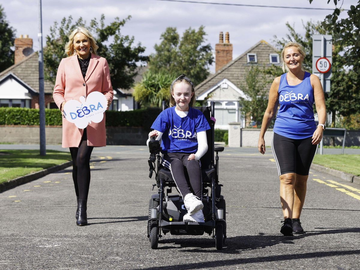 RTE's Miriam O'Callaghan with Claudia Scanlon and her mother Liz