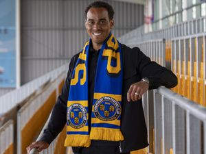 Shrewsbury Town unveil new signing Elliott Bennett.