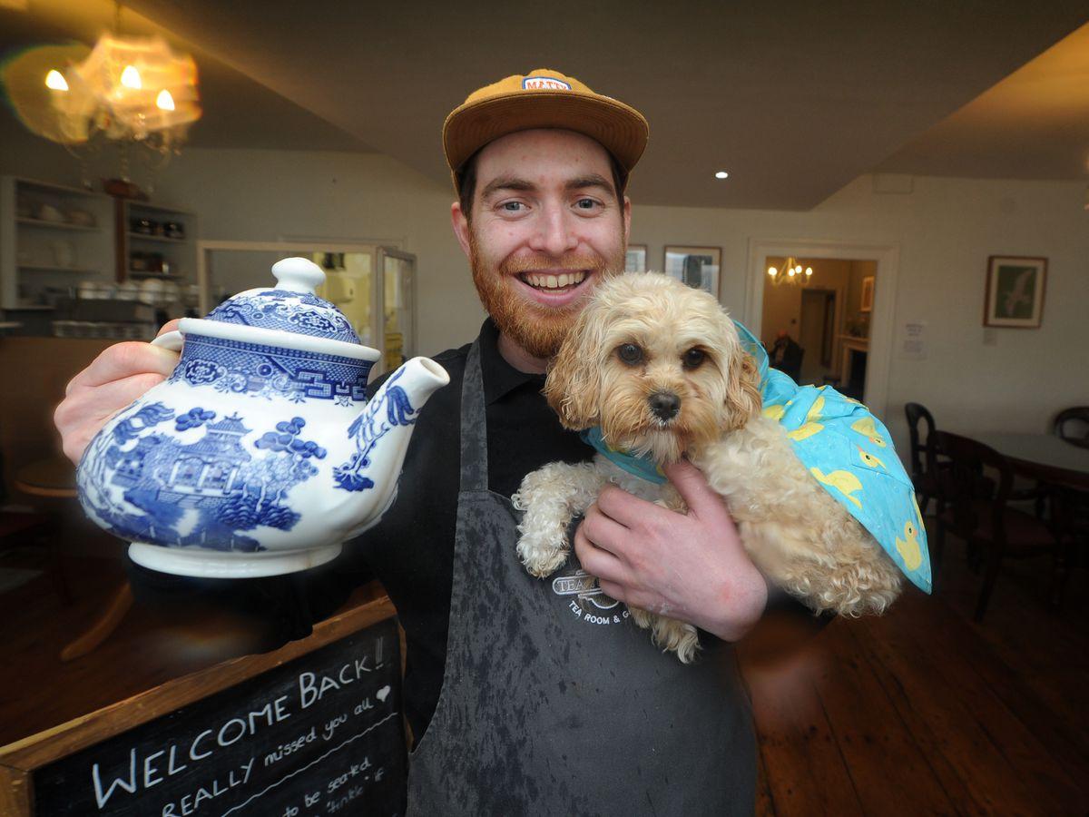 Tea Junction & More owner Jake Holdsworth with Frankie the dog