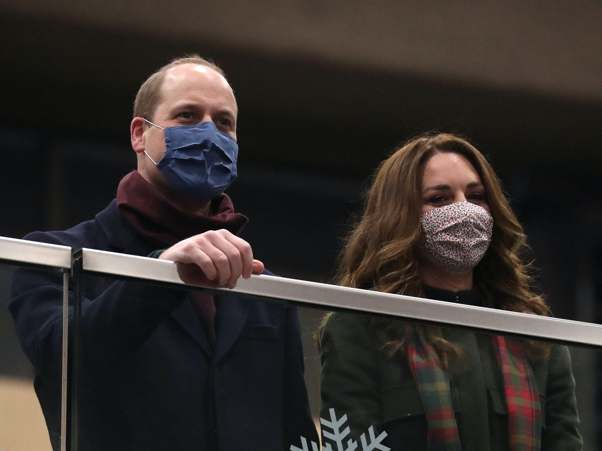 The Duke and Duchess of Cambridge look on from the balcony at London Euston Station ahead of boarding the royal train as they leave London for a tour across the UK. Chris Jackson/PA Wire