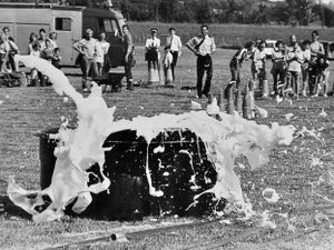 """nostalgia pic. Telford. """"Michael McLafferty of Donnington ambulance team makes quite a splash in the marathon team event at the Shropshire Fire Service It's a Knockout competition held at Telford Town Park on Saturday' reads the caption pasted on the back of this print in the Shropshire Star picture archive. It was taken on July 26, 1986, and published on July 28, 1986. The print has the Shropshire Star copyright stamp and the photographer was Jeff Millward. This is the second of a sequence of three pictures showing him jumping in and making a big splash (other two are also loaded on the digital picture library) and the specific caption for this photo was 'vanishing in the foam.' Library code: Telford nostalgia 2021.."""