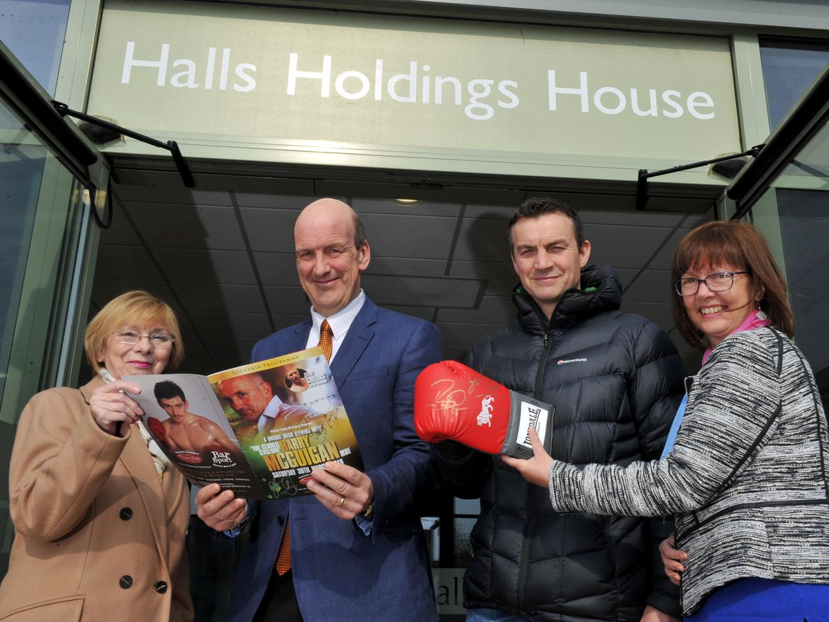 Hazel Jackson, left, and Tracy Watkins, right, of Pink Ribbon Breast Cancer Support, with Jeremy Lamond from Halls and Richie Woodhall, showing off the boxing glove signed by Barry McGuigan and Steve Collins which Richie is auctioning for the charity