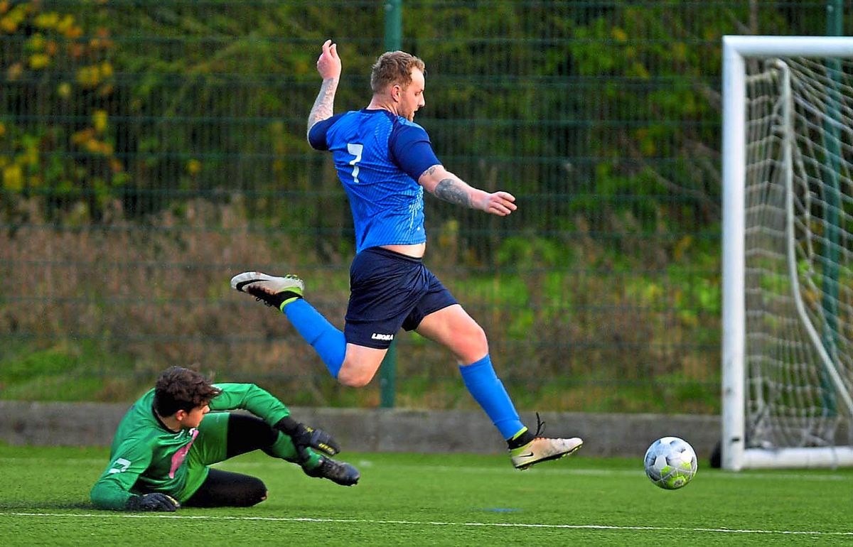 Newport's hat-trick man Ben Simmons rounds Chruch Stretton's Charles Parry