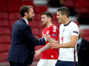England manager Gareth Southgate (left) shakes hands with Conor Coady