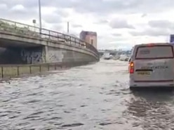 Motorists rescued from stranded vehicles after burst water main on London road