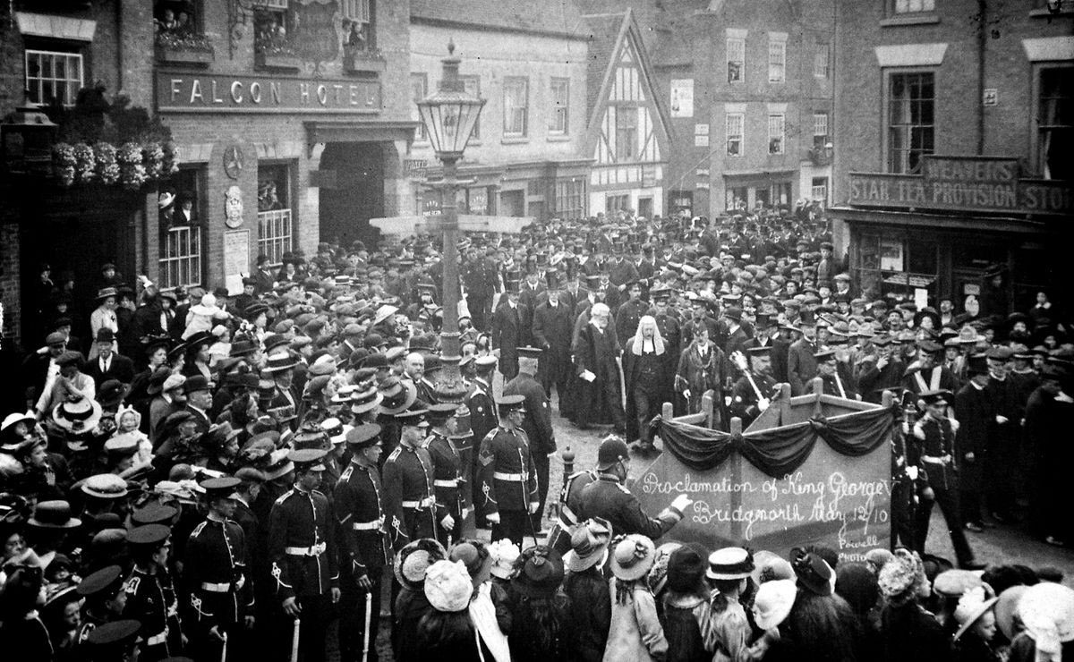 """The proclamation of King George V in Low Town, Bridgnorth, on May 12, 1910. They are in front of the Falcon Hotel. This is a postcard and the unpunctuated message on the back reads: """"Dear Annie, What do you think of this shouldn't you like to have been there when this was taken love from Auntie Doris/Davies (or something like that, last word difficult to read)."""" It was addressed to """"Miss Annie Taylor, of Blundell, Stottesdon, Cleobury Mortimer, Salop."""" This is from the large collection of Bridgnorth photos and other historical material which were accumulated by the late John Dixon, of Low Town, Bridgnorth, and loaned by his son Michael."""