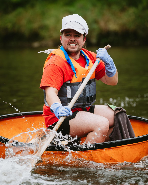 Alex Richardson taking part in the Ironbridge Coracle Regatta