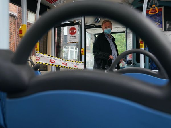 A passenger boards a bus