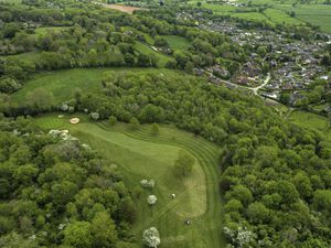 A view of the 4th hole at Llanymynech Golf Club where golfers tee off from Wales and putt in England