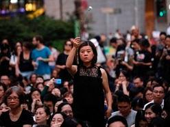 Hong Kong marchers gather as protester's death mourned