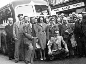 nostalgia pic. Shrewsbury. Staff of Walker printers in Shrewsbury in High Street just before they set off to Blackpool. Picture comes from Mrs Jessie Reich and believed to date from 1948. Jessie is one of the two girls  at the front and is on the left with her sister Ethelwyn next to her. Walker's printers. Picture via David Trumper. Library code: Shrewsbury nostalgia 2004a.