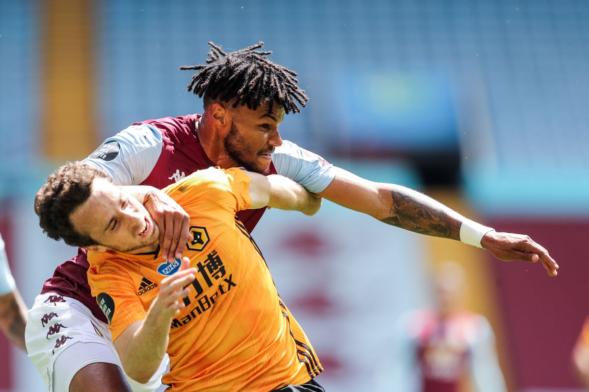 Diogo Jota of Wolverhampton Wanderers and Tyrone Mings of Aston Villa (AMA)