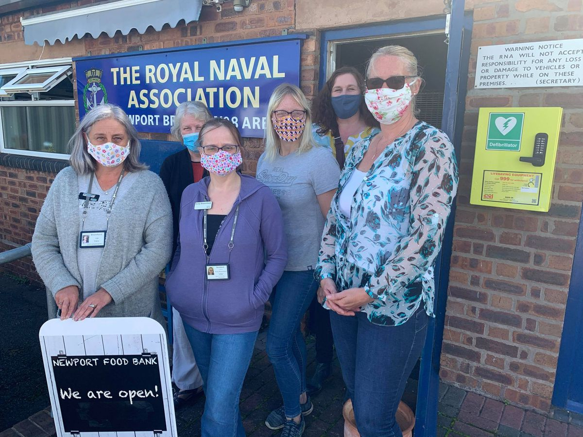 The team at Newport Food Bank outside the town's navy club