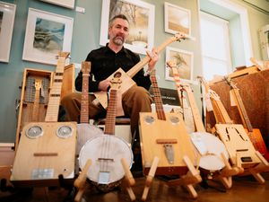 Bishops Castle Arts Festival 2020. In Picture: Artisan Market at the Town Hall - Jim Weston from Nobby Nicker Nacker - Cigar Box Guitars