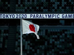 The Japanese flag flies during the opening ceremony for the 2020 Paralympics