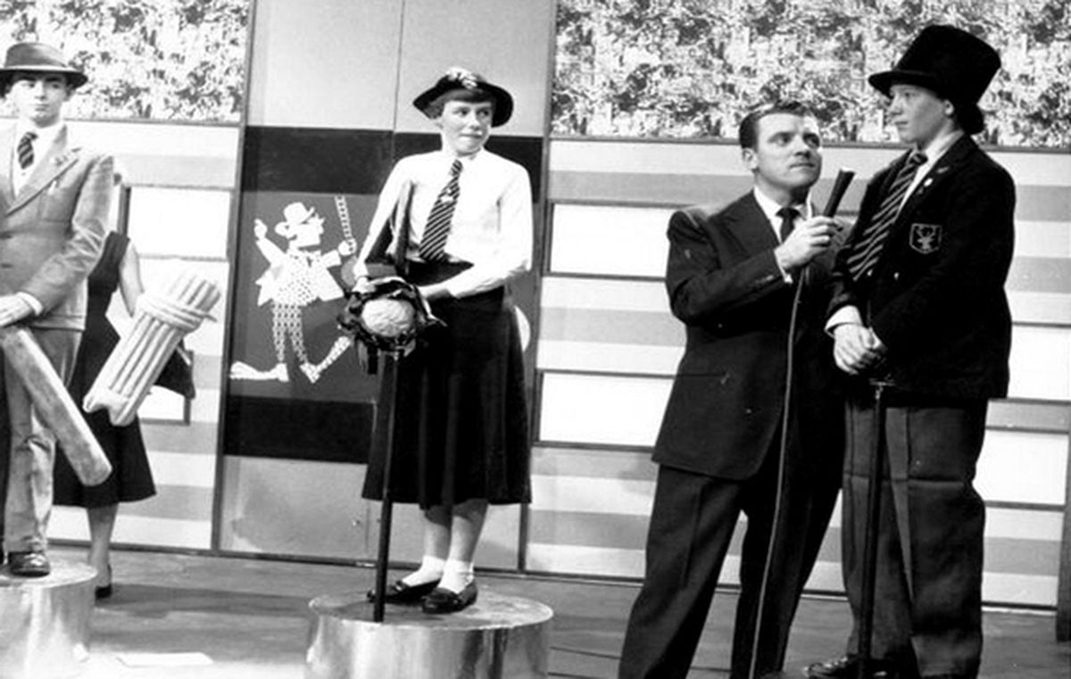 Eamonn Andrews oversees the clowing around on Crackerjack