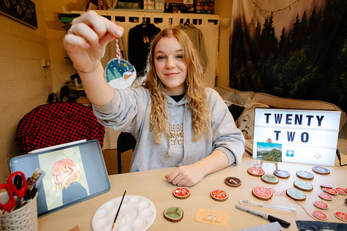 Annie Rogers works on her Christmas products
