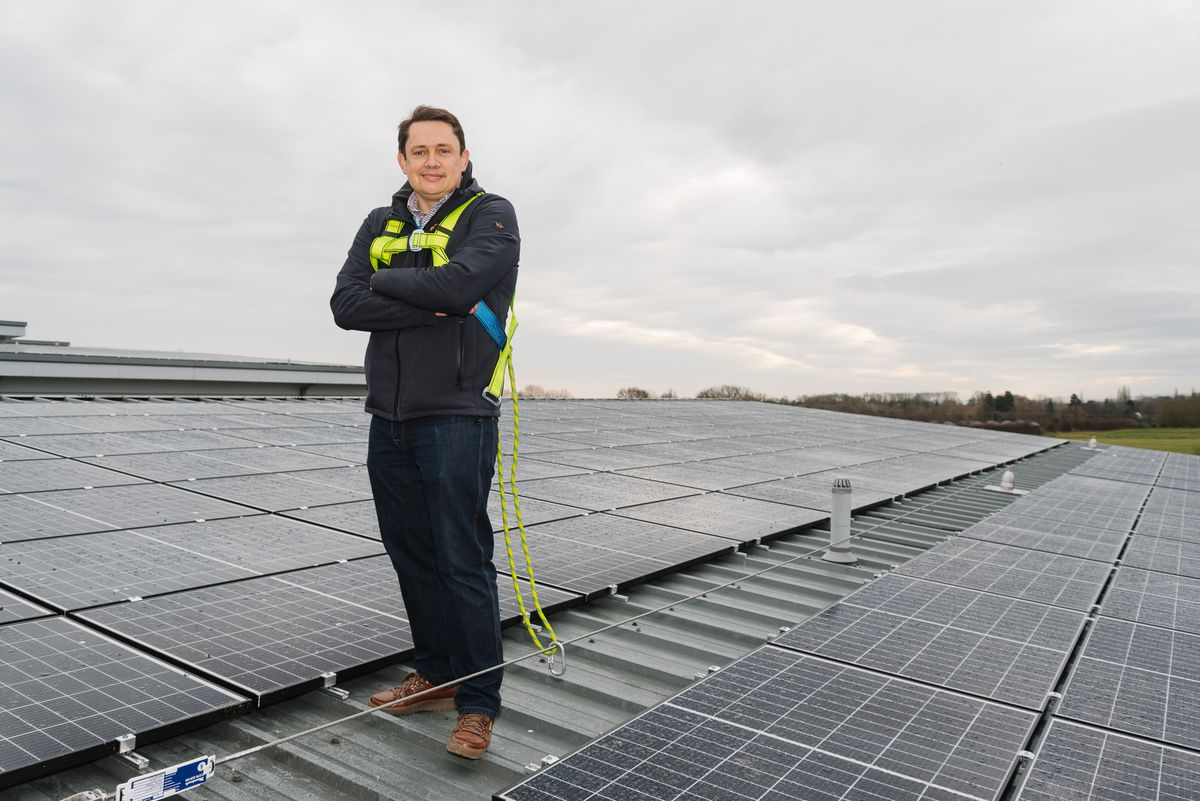 Mike Bowen, Capital Manager at RJAH, who has managed the project, stood alongside the solar panels, located above the hospital's main entrance