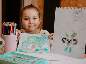 Lily-Rose Lawrence with some of her artwork