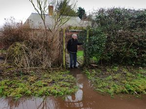 Neil Mytton is unhappy with the flooded road leading to his home at Brompton