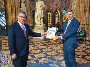 Philip Dunne, right, presents the report to Alok Sharma