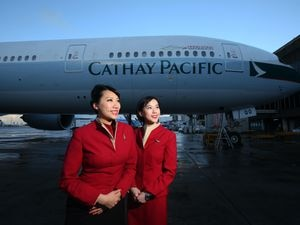 A Cathay Pacific plane and two stewardesses
