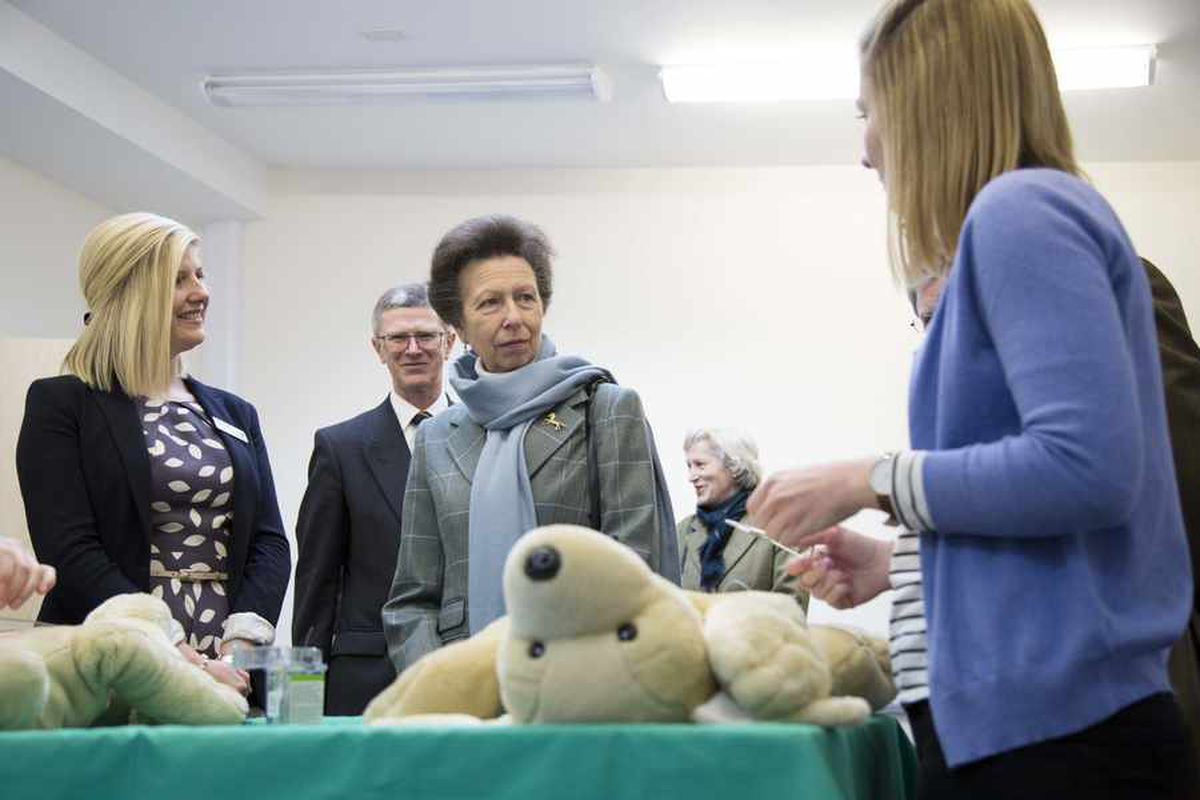 The princess observes a clinical skills class at Harper Adams, led by veterinary nursing teaching assistant Lucy Evans, left.