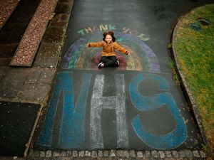 Missy Bennett, from Donnington in Telford, has drawn a large Thank You NHS on her street