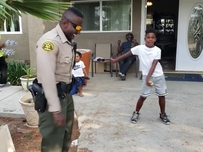Accidental 911 call leads to epic dance-off between police officer and kid