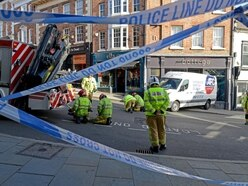 Woman jumps to safety as van reverses into Shrewsbury shop front - with video