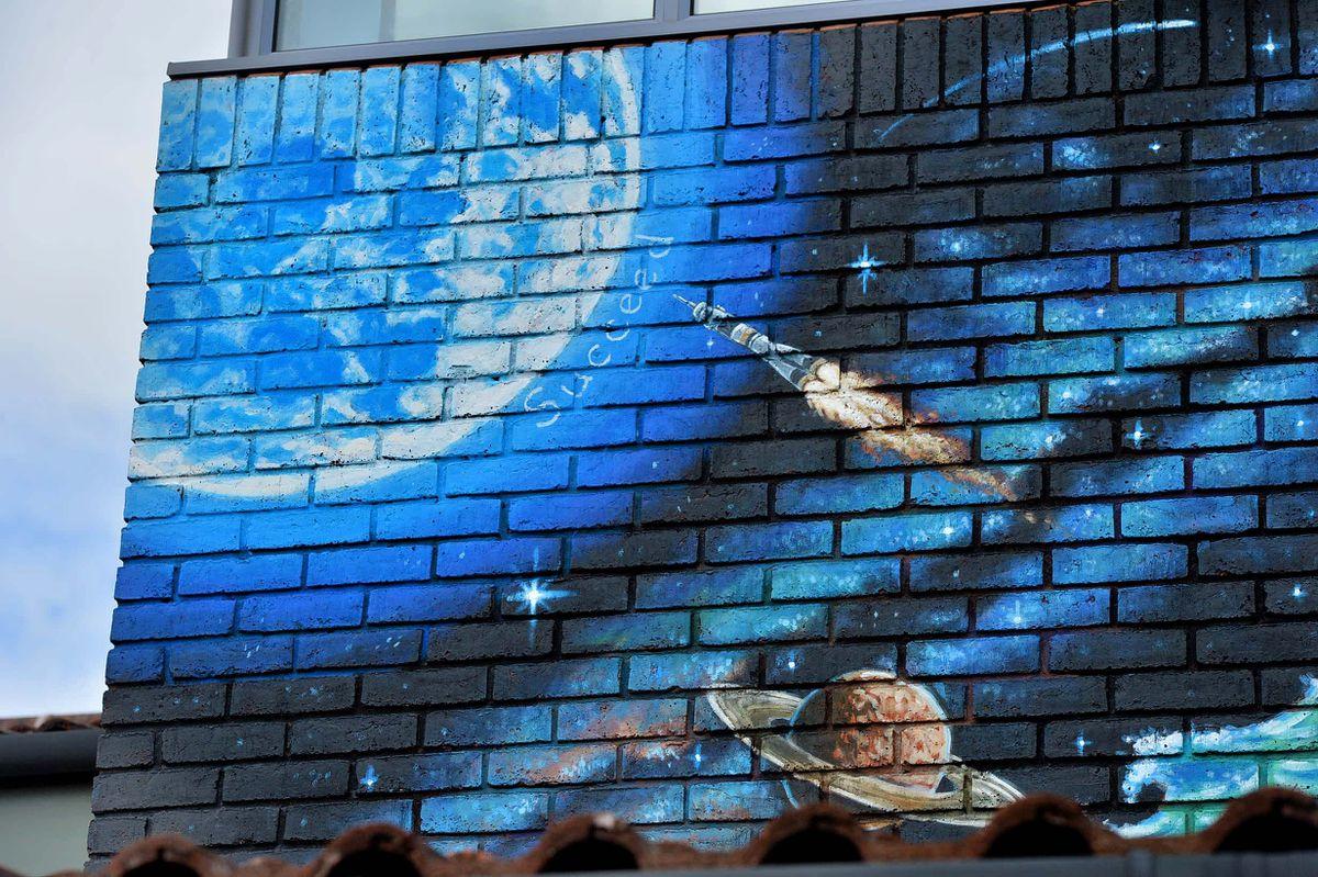 Artist Rory McCann's mural at Brown Clee Primary School