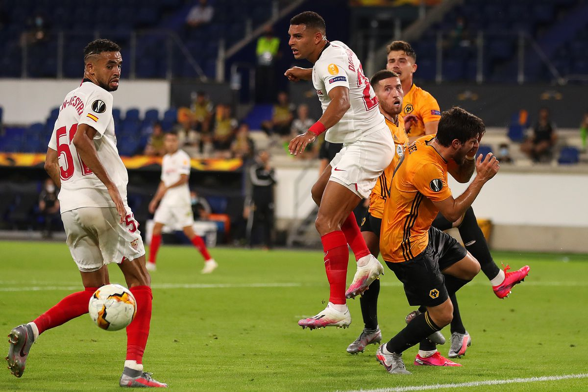 Ruben Neves of Wolverhampton Wanderers reacts after colliding with Diego Carlos of Seville (AMA)